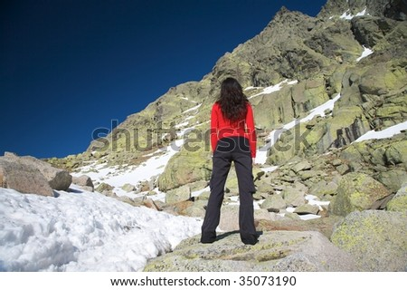 woman at the top of gredos mountains in avila spain
