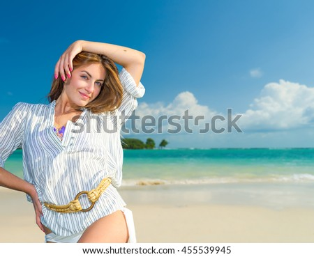 Woman at the tropical beach resort - stock photo