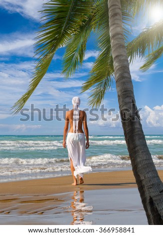 Woman at the tropical resort on holidays - stock photo