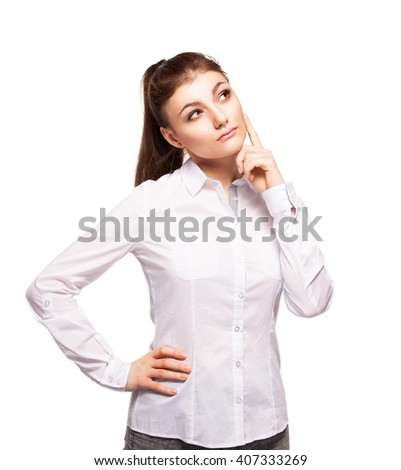 Woman at white background looking away. Young dreaming female isolated