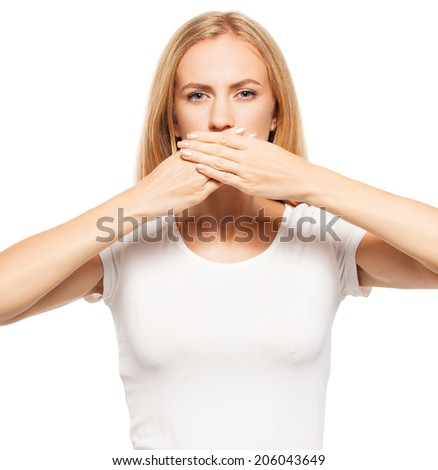 Woman at white background. Young female covering her mouth with her �¢??�¢??hands - stock photo
