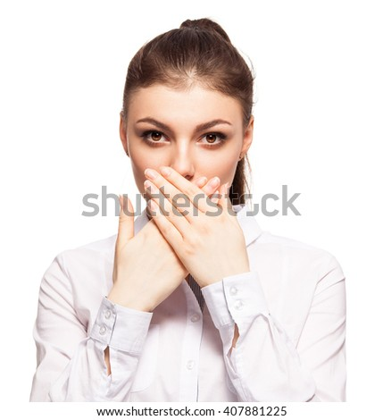 Woman at white background. Young female covering her mouth with her â??â??hands - stock photo