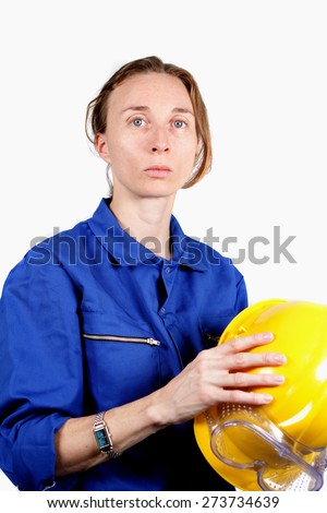 woman at work with safety helmet - stock photo