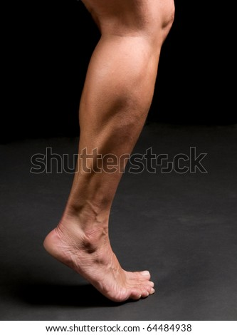 woman athlete's calf, ankle, and foot in action - stock photo