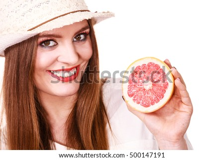Woman attractive long hair girl colorful eyes makeup holding two halfs of grapefruit citrus fruit in hands. Healthy diet food. Summer vacation holidays concept