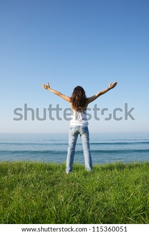 woman back at Arenal Moris beach in Asturias Spain - stock photo
