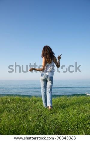 woman back at Arenal Moris beach in Asturias Spain - stock photo