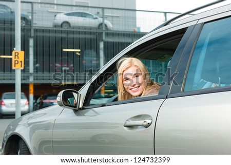 Woman back her car on a parking level or parking deck