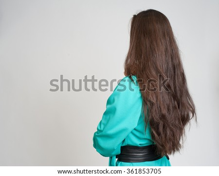 woman back view isolated on grey background - stock photo