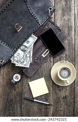 woman bag stuff and coffee over rustic wooden background - stock photo
