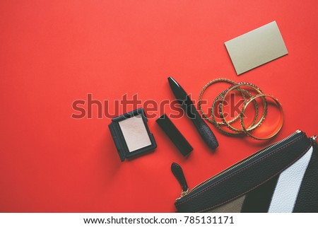 Woman bag cosmetics business card on stock photo royalty free woman bag with cosmetics and business card on red backgroundworking women concept colourmoves