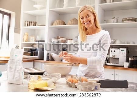 Woman baking at home - stock photo