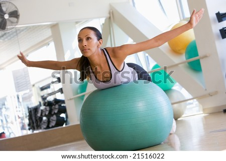 Woman Balancing On Swiss Ball - stock photo