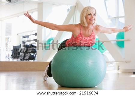 Woman Balancing On Swiss Ball - stock photo