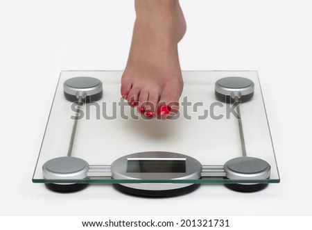 Woman Barefoot and Weight Scale - stock photo