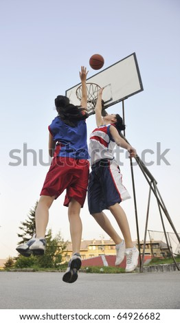 woman basketball player have treining and exercise at basketball court at city on street - stock photo