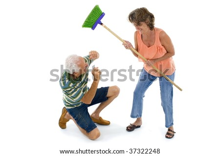 woman beating man with broom . - stock photo
