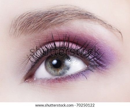 Woman beautiful eye with bright pink and violet makeup - stock photo