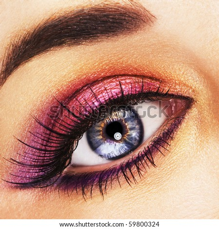 Woman beautiful eye with golden and pink makeup - stock photo