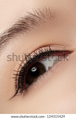 Woman beautiful eye with naturally long eyelashes. Macro shot. Wellness and spa, health and cosmetics. Natural make-up with black mascara on lashes. Long naturel eyelashes - stock photo