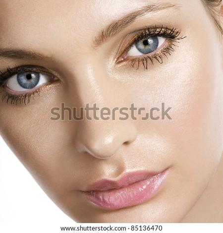 Woman beautiful face closeup - stock photo