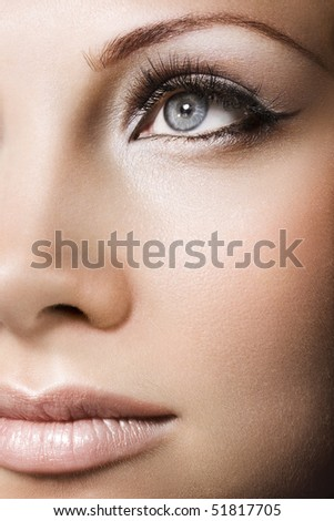 Woman beautiful face with perfect makeup - stock photo