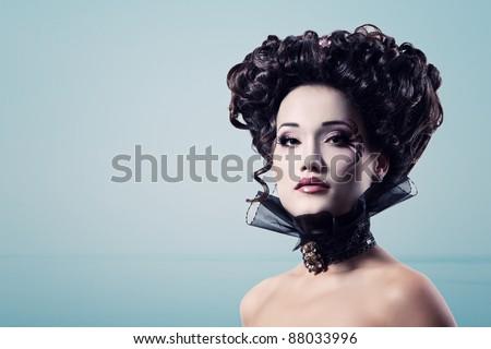 woman beautiful halloween vampire baroque aristocrat over blue background - stock photo