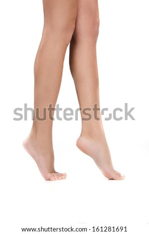 Woman beautiful legs. Isolated on white