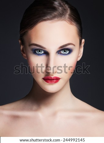 Woman beauty. Beautifil fashion portrait of young woman with evening professional make up. Blue eyes and red lips. Perfect skin. - stock photo