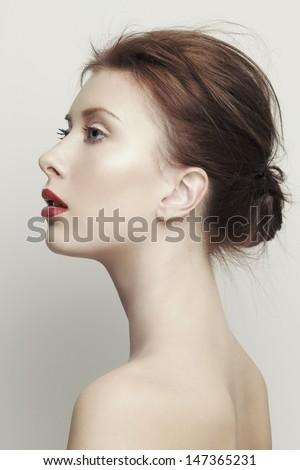 Woman beauty. Close up portrait of a beautiful woman. Studio shot. - stock photo