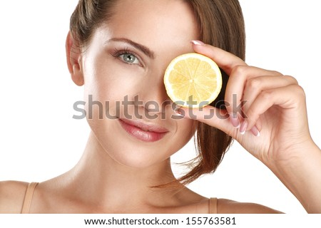 Woman beauty concept with fruits slices over eyes on white - stock photo
