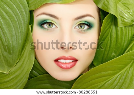 woman beauty face with green leaves frame isolated on white background - stock photo