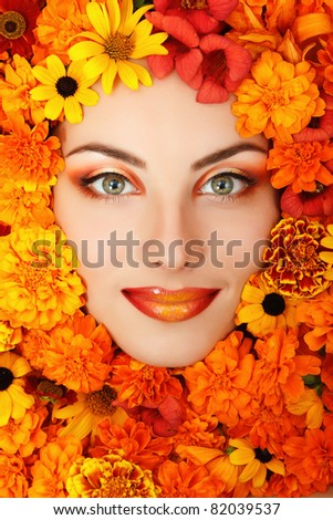 woman beauty face with orange flowers frame - stock photo