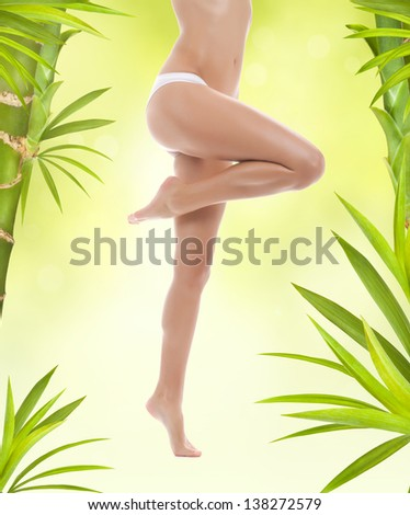 woman beauty long legs, body over green flower spring leaves, young girl in panties, beautiful female hip spa treatment wax and health skin care concept - stock photo