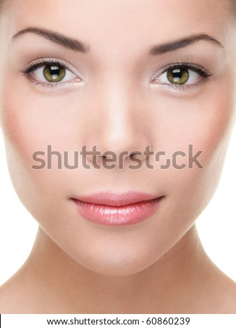 Woman beauty portrait closeup. Mixed race Asian / Caucasian woman with green eyes. Good for makeup, cosmetics and skin care. - stock photo
