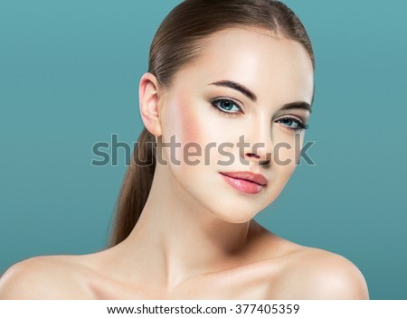 Woman beauty portrait isolated on white skin care concept on blue background  - stock photo