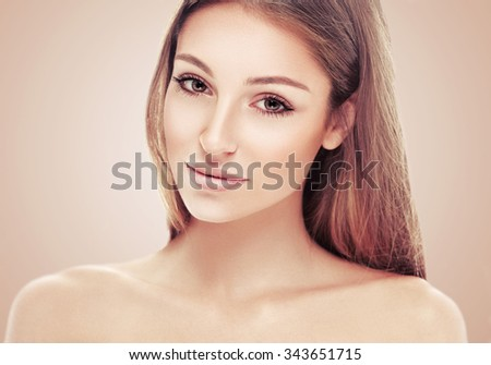 Woman beauty portrait on beige background