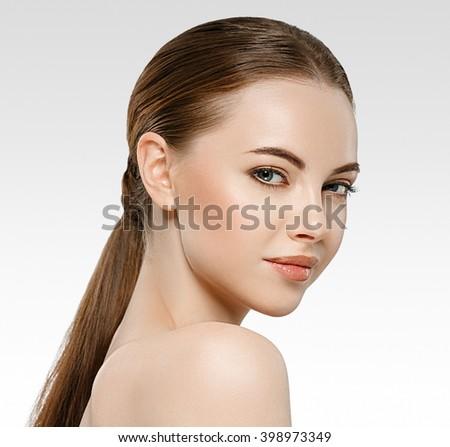 Woman beauty portrait studio closeup with healthy skin - stock photo