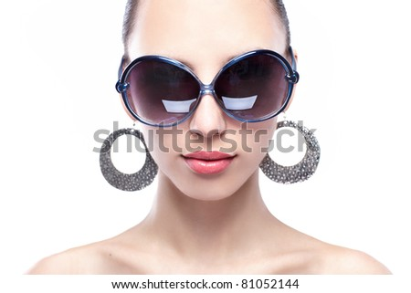woman beauty sunglasses with ear ring