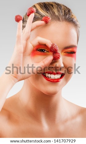 Woman beauty with raspberries