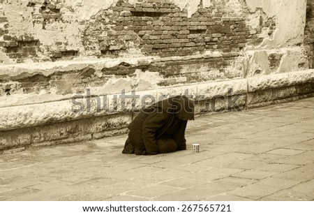 Woman begging in Venice (Italy). Aged photo. - stock photo
