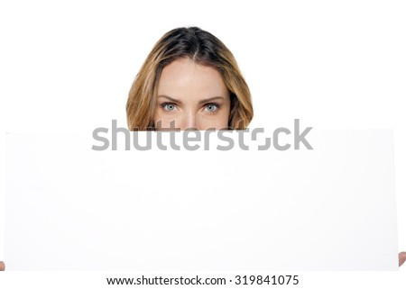 Woman behind a whiteboard - stock photo