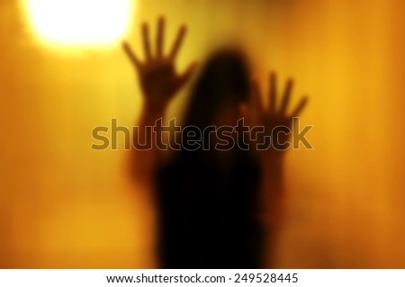Woman behind the matte glass. Blurry hand and body figure abstraction. - stock photo