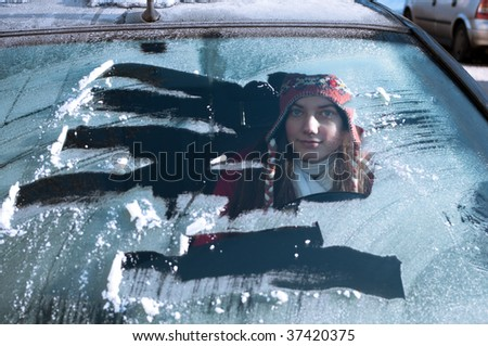 woman behind windshield in winter - stock photo