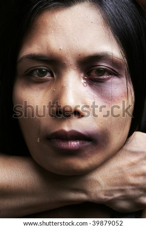 Woman being chocked and hurt, concept for domestic violence - stock photo
