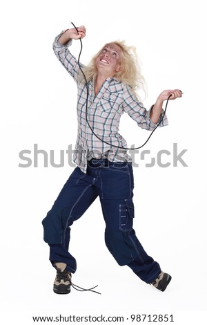 Woman being electrocuted - stock photo