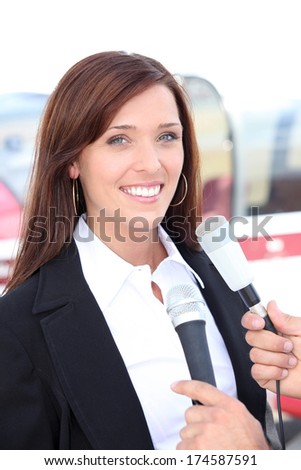 Woman being interviewed - stock photo