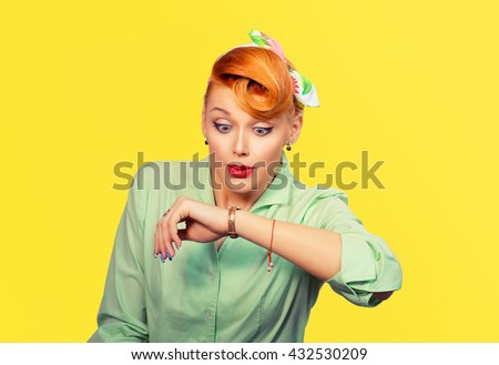 Woman being late to rendez-vous. Closeup portrait headshot view stressed young attractive beautiful businesswoman girl woman retro pinup bow hair style checking the time isolated yellow wall Mixt race