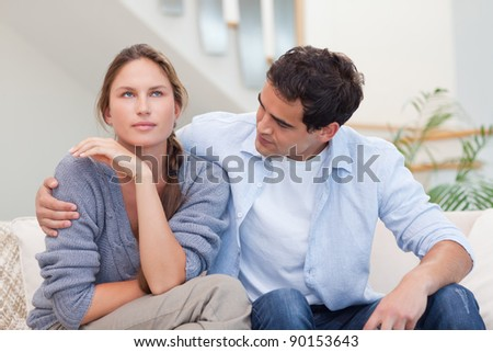 Woman being mad at her husband in their living room - stock photo