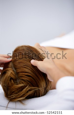 Woman being massaged - stock photo